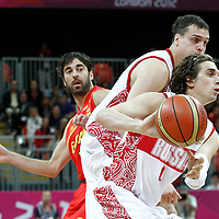 04 August 2012: Russia Alexey Shved makes the no-look pass as he drives past Spain Juan-Carlos Navarro on a screen set by Sasha Kaun during 77-74 Team Russia victory over Team Spain, during the men's basketball preliminary, at the Basketball Arena, in London, Great Britain.