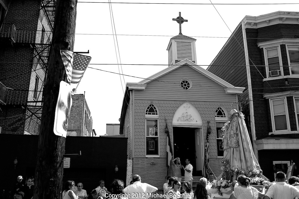 HOBOKEN, NJ - July 26:  People walk during a procession for the Feast of St. Ann on July 26, 2012 in HOBOKEN, NJ.  (Photo by Michael Bocchieri/Bocchieri Archive).