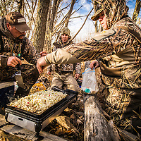 duck hunters cooking lunch during a hunt