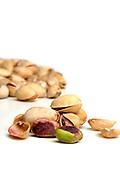 Studio shot  of pistachios on white background