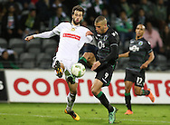 Nacional´s player Rui Correia (L ) fights for the ball with Sporting's player Slimani   (R ) during Portuguese First League football match Nacional vs Sporting held at Madeira Stadium, Funchal, Portugal, 13 February, 2016.  LUSA / GREGÓRIO CUNHA