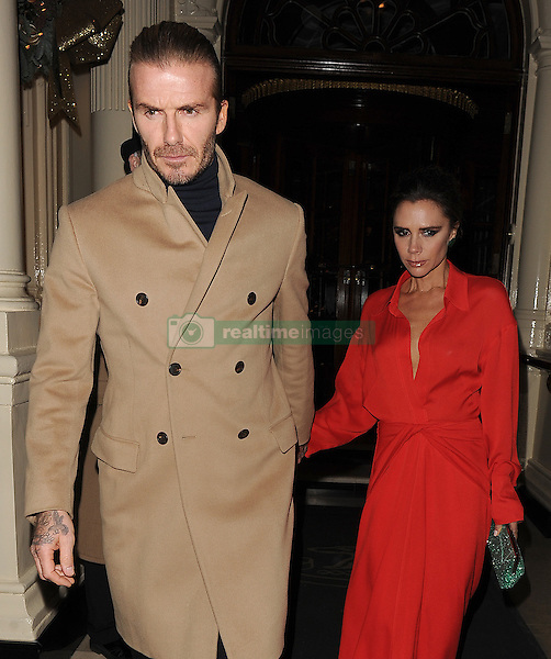 David Beckham and his wife Victoria Beckham leave The Connaught Hotel in Mayfair, having spent around 2 hours inside having a family meal with Victoria's sister Louise Adams, and her parents Jackie Adams and Anthony Adams. 14 Dec 2017 Pictured: David Beckham, Victoria Beckham. Photo credit: Will / MEGA TheMegaAgency.com +1 888 505 6342