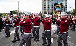 Flute band on traditional Orange Walk parade in central Glasgow , Scotland, United Kingdom