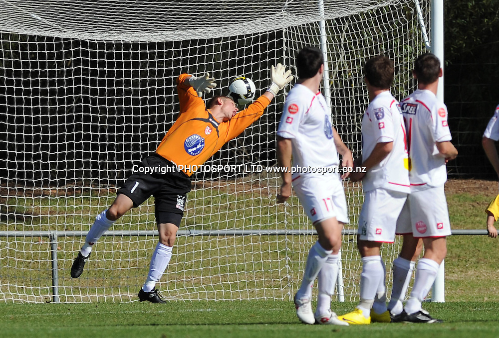 Waitakere goalie Danny Robinson watches the ball go into the net as Wellinton's Andy Barron scores the first goal.<br />NZFC Semi Final, Waitakere United v Team Wellington, Fred Taylor Park, Auckland<br />Saturday 10 April 2010. Photo: Andrew Cornaga/PHOTOSPORT