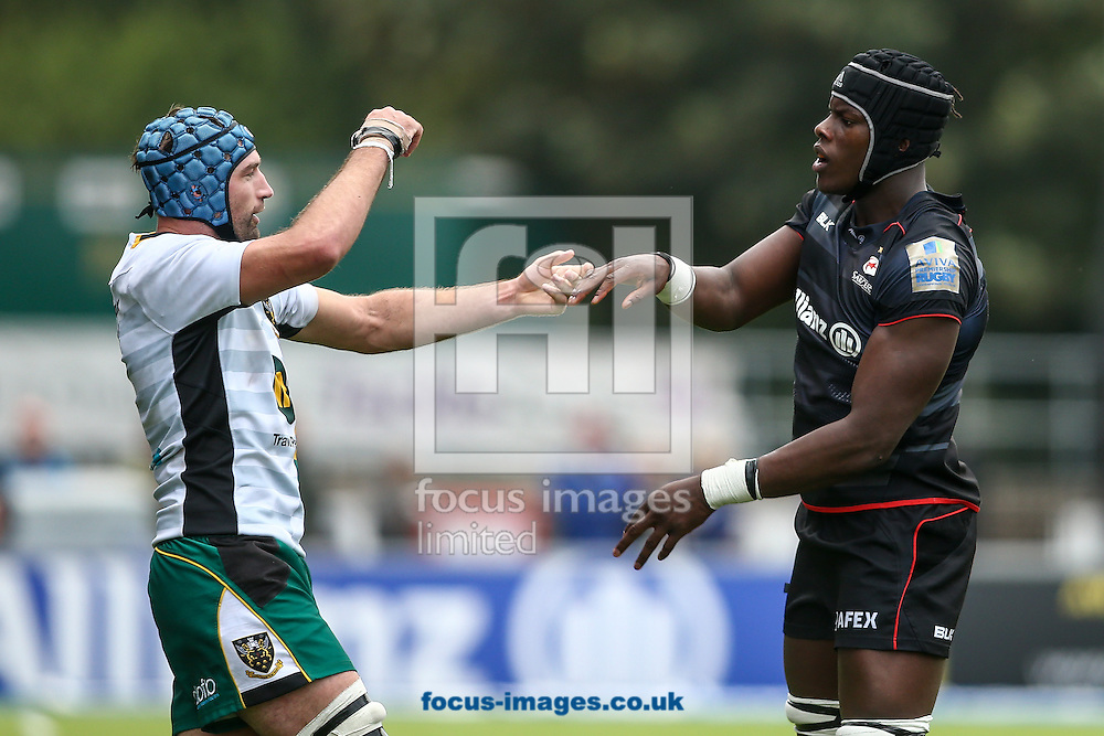 Michael Paterson of Northampton Saints (left) appears to ask Maro Itoje of Saracens (right) for a dance during the Aviva Premiership match at Allianz Park, London<br /> Picture by Andy Kearns/Focus Images Ltd 0781 864 4264<br /> 17/09/2016