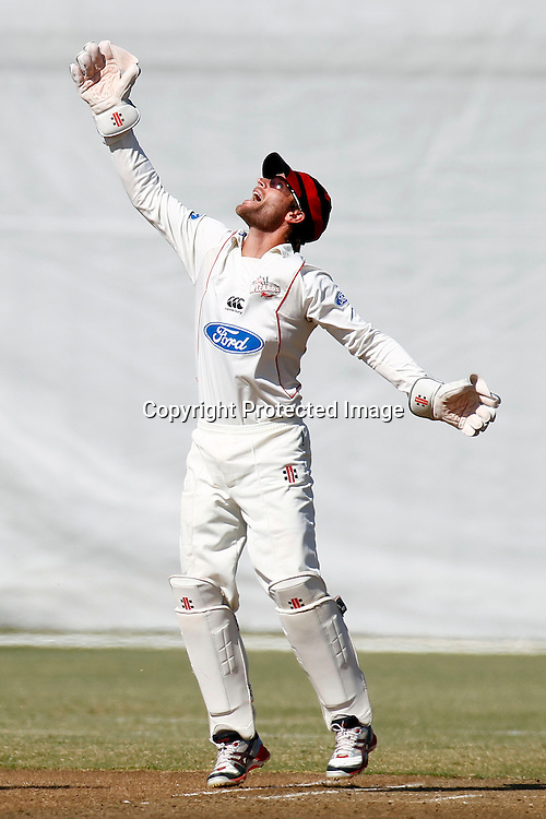 Colin de Grandhomme is caught behind by Reece Young, pictured celebrating, Plunket shield cricket. Auckland Aces v Canterbury Wizards. 4 Day domestic cricket. Colin Maiden Park, Auckland. 27 March 2012. Photo: William Booth/photosport.co.nz
