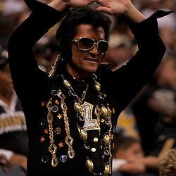 2009 October 18: A New Orleans Saints fan dressed as Elvis in the stands during a 48-27 win by the New Orleans Saints over the New York Giants at the Louisiana Superdome in New Orleans, Louisiana.