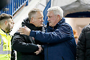 Sheffield United Manager Chris Wilder and Sheffield Wednesday Manager Steve Bruce embrace during the EFL Sky Bet Championship match between Sheffield Wednesday and Sheffield United at Hillsborough, Sheffield, England on 4 March 2019.