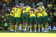 Picture by Paul Chesterton/Focus Images Ltd.  07904 640267.19/11/11.The Norwich team in their pre match huddle before the Barclays Premier League match at Carrow Road stadium, Norwich.