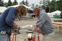 Mitch Leocha and Shawn Reynolds work on building stages and beer tubs in preparation for Laconia Fest coming to Motorcycle Week at the Weirs Beach Drive In Theater.  (Karen Bobotas/for the Laconia Daily Sun)