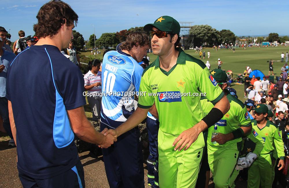 Umar Gul shakes hands with Colin de Grandhomme. Twenty20 Cricket, Auckland Aces v Pakistan, Colin Maiden Park, Auckland. Thursday 23 December 2010.Photo: Andrew Cornaga/photosport.co.nz