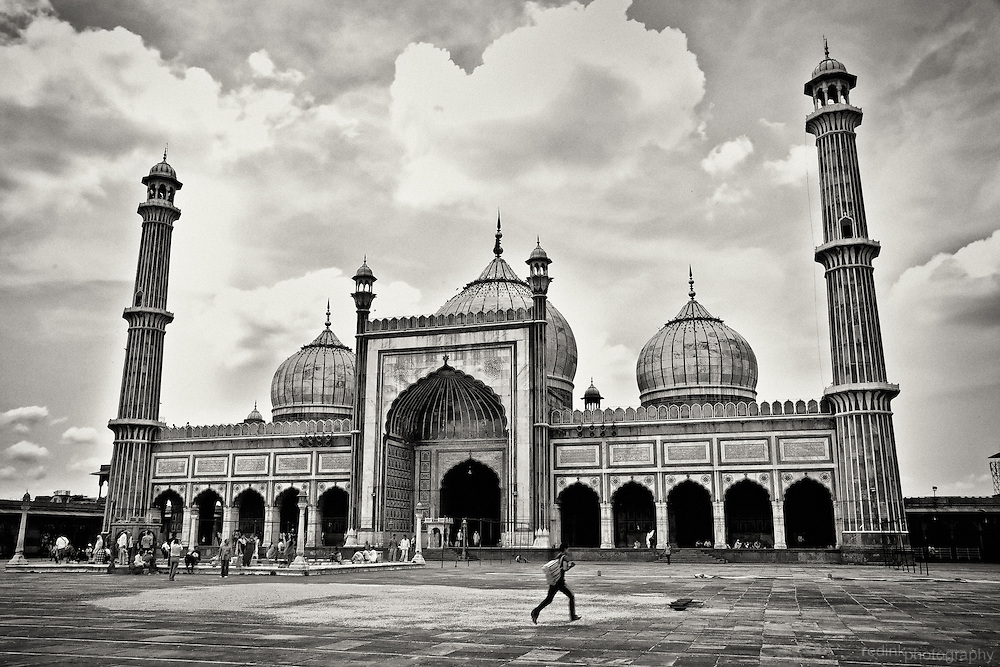 A young man runs across the plaza in front of Jama Masjid in New Delhi, India. Converted to black and white using Silver Efex Pro.
