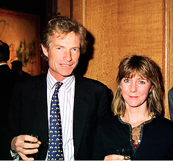 MR & MRS ERSKINE GUINNESS at a reception in London on 22nd March 1999.MPO 14 2oro