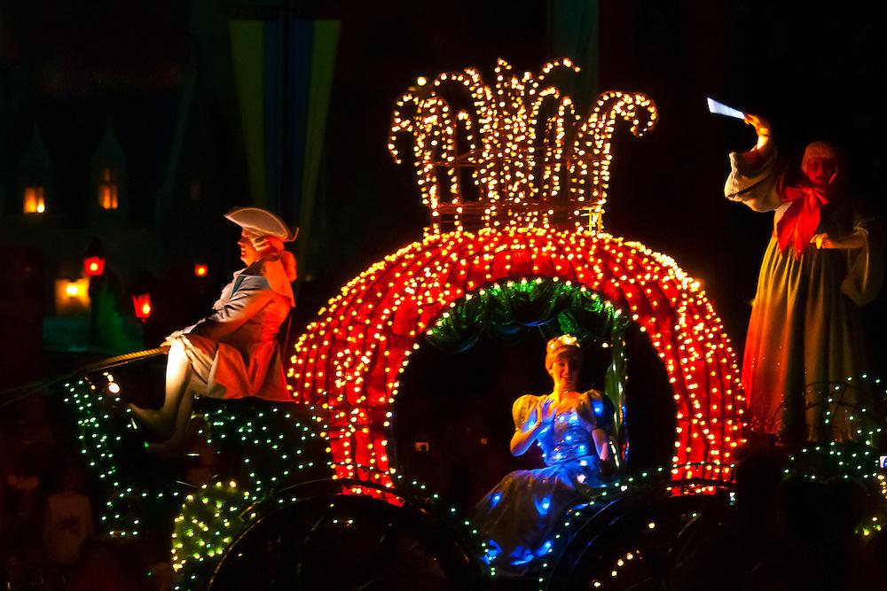 Cinderella, Disney's Electrical Parade (with Cinderella Castle in back), Magic Kingdom, Walt Disney World, Orlando, Florida USA