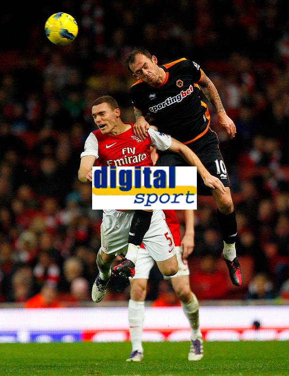 20111227: LONDON, UK - Barclays Premier League 2011/2012: Arsenal vS Wolverhampton Wanderers.<br /> In photo: Thomas Vermaelen of Arsenal and Steven Fletcher of Wolverhampton Wanderers leap for the ball.<br /> PHOTO: CITYFILES