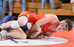 Mike Grogan takes on UNC's Jake Puckett in an ACC dual meet at Memorial Gymnasium.  Grogan easily won the 174lb match 16-1, as UVA beat the Tar Heels 27-10.
