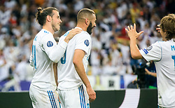 Gareth Bale, Karim Benzema and Luka Modric of Real Madrid celebrate after Bale scored first goal during the UEFA Champions League final football match between Liverpool and Real Madrid at the Olympic Stadium in Kiev, Ukraine on May 26, 2018.Photo by Sandi Fiser / Sportida