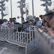 Camera operators and race car spotters are seen on the newly build grandstand rooftop during the 58th Annual NASCAR Daytona 500 auto race at Daytona International Speedway on Sunday, February 21, 2016 in Daytona Beach, Florida.  (Alex Menendez via AP)