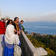 Tourists admire the view from the Topkapi Palace over the Bosphorus.