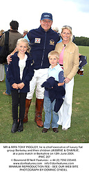 MR & MRS TONY PIDGLEY, he is chief executive of luxury flat group Berkeley and their children JASMINE & CHARLIE, at a polo match in Berkshire on 12th June 2004.<br /> PWC 207