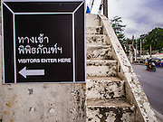 13 AUGUST 2016 - BANGKOK, THAILAND:       A sign for tourists who want to visit the Pom Mahakan slum in Bangkok. Residents of the slum have been told they must leave the fort and that their community will be torn down. The community is known for fireworks, fighting cocks and bird cages. Mahakan Fort was built in 1783 during the reign of Siamese King Rama I. It was one of 14 fortresses designed to protect Bangkok from foreign invaders. Only of two are remaining, the others have been torn down. A community developed in the fort when people started building houses and moving into it during the reign of King Rama V (1868-1910). The land was expropriated by Bangkok city government in 1992, but the people living in the fort refused to move. In 2004 courts ruled against the residents and said the city could take the land. Eviction notices have been posted in the community but most residents have refused to move. Residents think Bangkok city officials will start evictions around August 15, but there has not been any official word from the city.   PHOTO BY JACK KURTZ