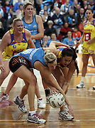 Paula Griffin and Demelza McCloud compete for the ball.<br /> ANZ Championship - Steel v Pulse, 28 May 2012, The Edgar Centre, Dunedin, New Zealand.<br /> Photo: Rob Jefferies / photosport.co.nz