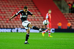 Bristol City's Bobby Reid takes a shot at goal. - Photo mandatory by-line: Dougie Allward/JMP - Tel: Mobile: 07966 386802 24/09/2013 - SPORT - FOOTBALL - St Mary's Stadium - Southampton - Southampton V Bristol City - Capital One Cup