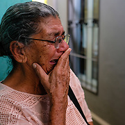 Soyla Benitez tries to hold back her tears as she describes her despair after her youngest son attemped to immigrate to the US.  It's believed he drowned the Rio Grande.  A body has yet to be recovered.  He left in 1992 and Soyla continues to go to meetings run by Cofamipro.  Rosanelli Santo runs the organization which is a non for profit.  Cofamipro keeps track of missing immigrants and tries to find information for the families. It's the only organization in Honduras that provides this service.  The government doesn't have a program yet to help find missing immigrants. El Progreso, Honduras on February 11, 2017.