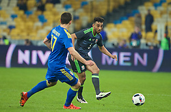 KIEV, UKRAINE - Easter Monday, March 28, 2016: Wales' Neil Taylor in action against Ukraine during the International Friendly match at the NSK Olimpiyskyi Stadium. (Pic by David Rawcliffe/Propaganda)