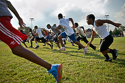 Jordan Beverly, 12, Robert Conner 3rd, 13, Rasheed  Campbell, 11 and Gatson Campbell, 9, run during football practice in River Rouge, Detroit,  August 15, 2012.   Many of his kids have asthma and the coach has to constantly monitor and ask them if they need inhalers during practice.