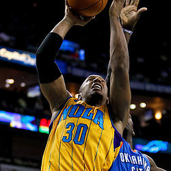 December 10, 2010; New Orleans, LA, USA; New Orleans Hornets power forward David West (30) shoots over Oklahoma City Thunder forward Jeff Green (22) during the second half at the New Orleans Arena.  The Thunder defeated the Hornets 97-92. Mandatory Credit: Derick E. Hingle-US PRESSWIRE