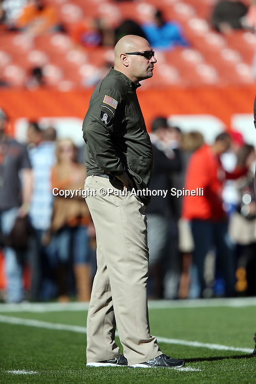Cleveland Browns head coach Mike Pettine watches pregame warmups before the 2015 week 8 regular season NFL football game against the Arizona Cardinals on Sunday, Nov. 1, 2015 in Cleveland. The Cardinals won the game 34-20. (©Paul Anthony Spinelli)