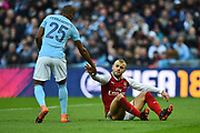 Fernandinho (25) of Manchester City helps Jack Wilshere (10) of Arsenal up during the EFL Cup Final match between Arsenal and Manchester City at Wembley Stadium, London, England on 25 February 2018. Picture by Graham Hunt.