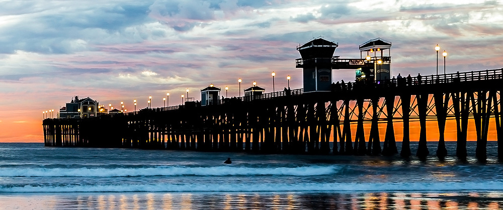 Sunset Surf Session At Oceanside Pier