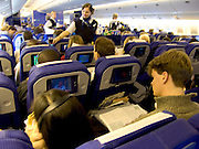 Passengers seated in economy class cabin of a jet aircraft