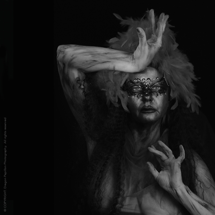 capturing the spirit of the phoenix rising from the flames, a black and white torso portrait