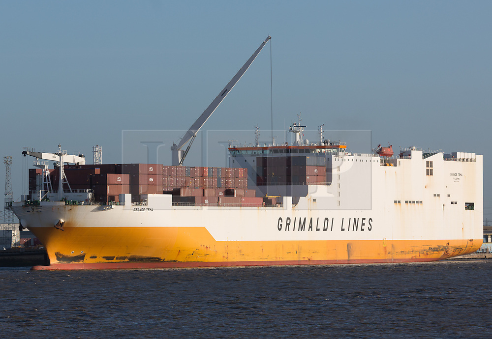 © Licensed to London News Pictures. 22/12/2018. Tilbury, UK. The Grimaldi Lines cargo ship Grande Tema pictured at Tilbury this morning where it has docked after stowaways threatened the crew of the vessel in the Thames Estuary. Essex Police boarded the ship and it was brought to Tilbury where four men who were on board have since been held under the Immigration Act. Photo credit : Rob Powell/LNP