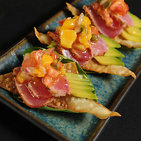 Tuna Tacos, sliced blackened Ahi tuna and avocado, set atop crispy wonton shells, finished with a tomato mango relish at Aubriana's Friday June 4, 2010. Photo By Mike Spencer/STAR-NEWS