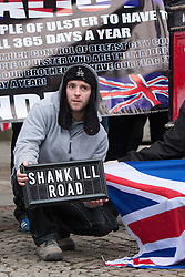 "© Licensed to London News Pictures . 19/01/2013 . Manchester , UK . A man holds a "" Shankill Road "" sign . Loyalist protesters demonstrate outside Manchester Town Hall in the city's Albert Square , today (19th January 2013) . Photo credit : Joel Goodman/LNP"