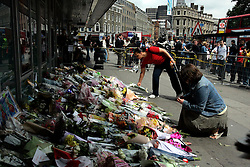 UK ENGLAND LONDON 9JUL05 - Members of the public and relatives of casualties of the London underground bombings lay down flowers at Kings Cross station in central London. At least 49 people have been killed and hundreds injured after four blasts on the Underground network and a double-decker bus in London...jre/Photo by Jiri Rezac ..© Jiri Rezac 2005..Contact: +44 (0) 7050 110 417.Mobile:  +44 (0) 7801 337 683.Office:  +44 (0) 20 8968 9635..Email:   jiri@jirirezac.com.Web:    www.jirirezac.com..© All images Jiri Rezac 2005 - All rights reserved.