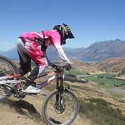 Kaytee Campbell from Ngaruawahia in action during the New Zealand South Island Downhill Cup Mountain Bike series held on The Remarkables face with a stunning backdrop of the Wakatipu Basin. 150 riders took part in the two day event. Queenstown, Otago, New Zealand. 9th January 2012. Photo Tim Clayton