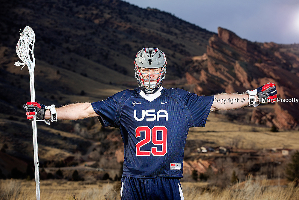 SHOT 2/22/14 4:55:27 PM - Denver Outlaws and Team USA defenseman Lee Zink poses for a portrait with Red Rocks and the foothills just outside of Denver, Co. in the background. Zink was named the 2012 Major League Lacrosse Defensive Player of the Year. When Zink grew up in Darien, Conn., and started his lacrosse career in sixth grade, he knew defense would be his calling card from the beginning. Zink will be playing in Denver this summer in the 2014 FIL World Lacrosse Championships.<br /> (Photo by Marc Piscotty / &copy; 2014)