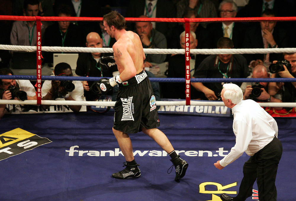 Enzo Maccarinelli staggers across the ring after being knocked down. WBA and WBC champion David Haye knocked out WBO champion Enzo Maccarinelli in two rounds on Saturday night at the O2 Arena in London. 8th March 2008.