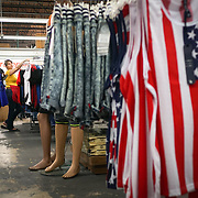 HIALEAH, FLORIDA - JUNE 24, 2016<br /> Esbel Ruiz  receives assistance as he shops for  clothing  in Noooo (&ntilde;oooo) Que Barato,  in Hialeah, Florida. The store sells all kinds of goods and is a very popular stop for Cubans who are traveling to Cuba to stock up on supplies to carry to relatives in the island nation. Ruiz was buying items to send with to Cuba carried by someone else.<br /> (Photo by Angel Valentin/Freelance)