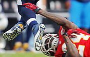Kansas City Chiefs cornerback Brandon Flowers (24) attempts to grab San Diego Chargers running back Ryan Mathews in the 3rd quarter of their NFL football game, Sunday, Sept. 30, 2012, in Kansas City, Mo. The Chargers defeated the Chiefs 37-20. (AP Photo/Colin E Braley)