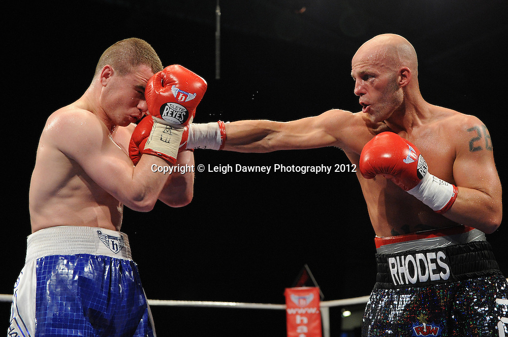 Sergey Rabchenko defeats Ryan Rhodes (Rhodes is winded) in a 12x3 min round contest to claim the vacant EBU European Light Middleweight Title at the Velodrome, Manchester on the 16.06.12. Hatton Promotions. ©Leigh Dawney Photography 2012.