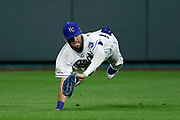 Kansas City Royals center fielder Bubba Starling makes a diving catch on a fly ball hit by Cleveland Indians' Mike Freeman in the sixth inning of a baseball game at Kauffman Stadium in Kansas City, Mo., Friday, July 26, 2019. (AP Photo/Colin E. Braley)