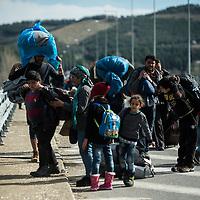 Idomeni 04-03-2016 Greek-Macedonian border, refugee camp of Idomeni; migrant groups marching through the streets and farmland towards the Idomeni refugee camp