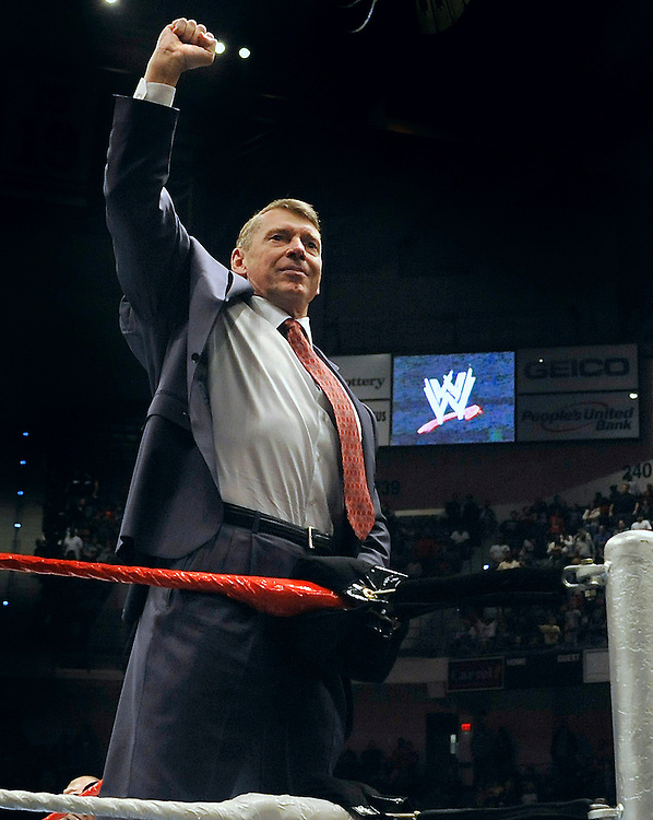 Vince McMahon, husband of Republican candidate for U.S. Senate Linda McMahon raises his arm in the air to an audience during a fan appreciation event in Hartford, Conn., Saturday, Oct. 30, 2010. Former World Wrestling Entertainment CEO McMahon is battling Richard Blumenthal, the Connecticut  Attorney General, for the senate seat being vacated by the retiring Sen. Chris Dodd.  (AP Photo/Jessica Hill)