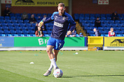 AFC Wimbledon midfielder Scott Wagstaff (7) warming up during the EFL Sky Bet League 1 match between AFC Wimbledon and Portsmouth at the Cherry Red Records Stadium, Kingston, England on 19 October 2019.